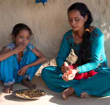 Kalpana Oli with her daughter Binita. Credit: Aubrey Wade